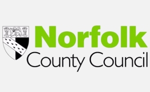 Norfolk in bold green text, County Council black text underneath, black and white shield graphic with Norfolk coat of arms on left